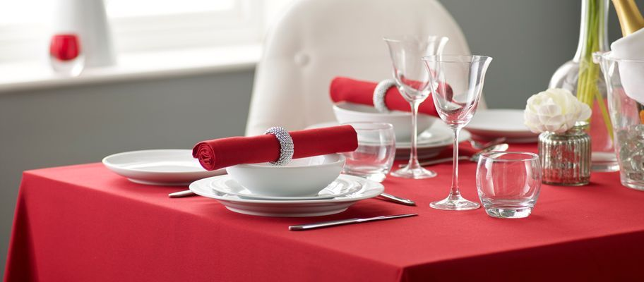 Red polyester tablecloth with table setting
